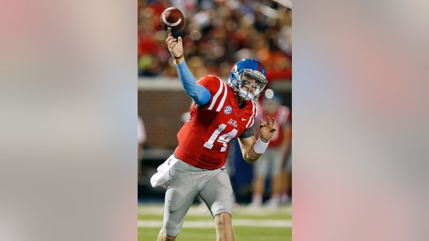 Mississippi quarterback Bo Wallace passes in the first half of an NCAA college football game against Memphis in Oxford, Miss., Saturday, Sept. 27, 2014.  (AP Photo/Rogelio V. Solis)