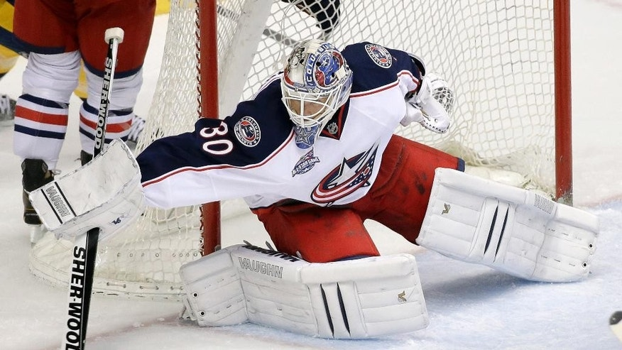 Columbus Blue Jackets goalie Curtis McElhinney (30) blocks a shot against the Nashville Predators in the second period of a preseason NHL hockey game Monday, Sept. 29, 2014, in Nashville, Tenn. McElhinney shut out the Predators 3-0. (AP Photo/Mark Humphrey)