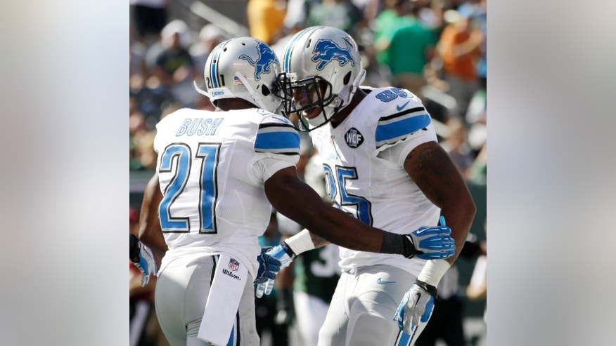 Detroit Lions running back Reggie Bush (21) and tight end Eric Ebron (85) celebrate Ebron's touchdown reception against the New York Jets during the first half of an NFL football game, Sunday, Sept. 28, 2014, in East Rutherford, N.J. (AP Photo/Frank Franklin II)