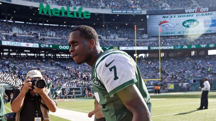 In this photo taken on Sunday, Sept. 28, 2014, New York Jets quarterback Geno Smith walks off the field after losing 24-17 to the Detroit Lions during an NFL football game in East Rutherford, N.J. Frustrated after a third straight loss and calls for his backup increasing, Smith was caught by a TV camera yelling an expletive at a heckler in the stands as he walked off the MetLife Stadium field following a 24-17 loss to the Detroit Lions on Sunday. (AP Photo/Kathy Willens, File)