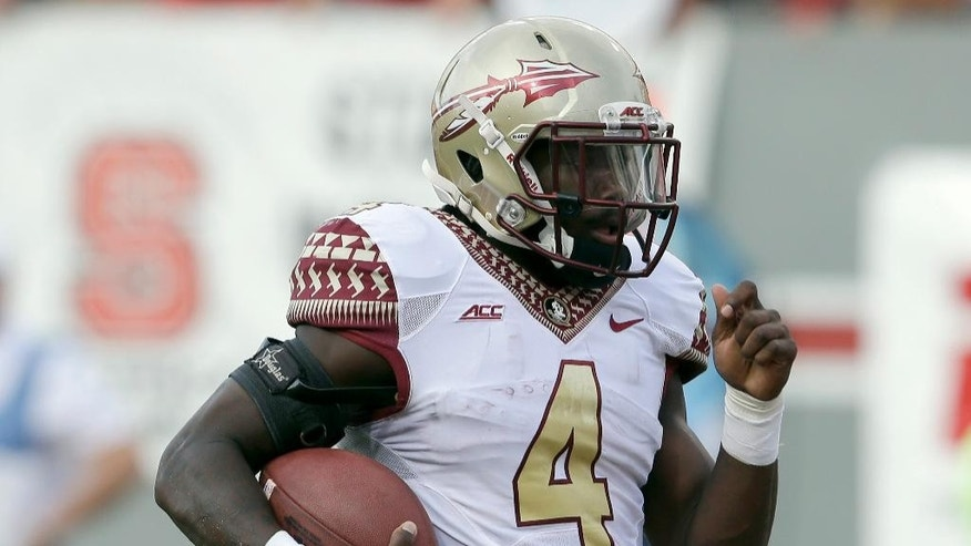 Florida State's Dalvin Cook (4) runs for a touchdown against North Carolina State during the second half of an NCAA college football game in Raleigh, N.C., Saturday, Sept. 27, 2014. Florida State won 56-41.(AP Photo/Gerry Broome)