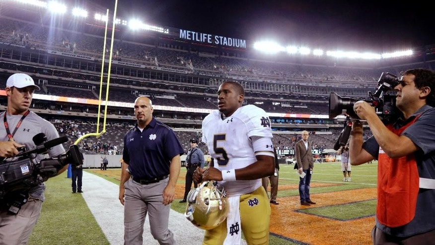 Notre Dame quarterback Everett Golson (5) leaves the field after an NCAA college football game against Syracuse, Saturday, Sept. 27, 2014, in East Rutherford, N.J. Notre Dame won 31-15. (AP Photo/Julio Cortez)