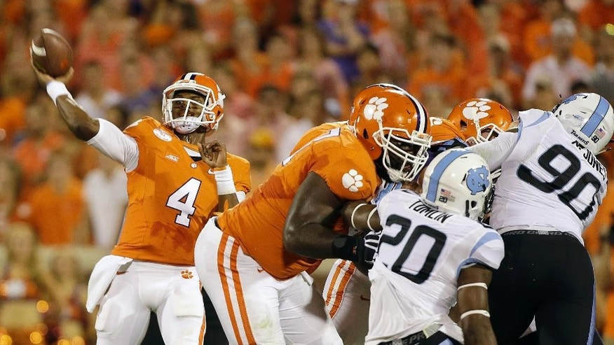 Clemson's Deshaun Watson (4) throws a pass against the North Carolina defense that connected for a touchdown in the first half of an NCAA college football game in Clemson, S.C., Saturday Sept. 27, 2014. (AP Photo?Bob Leverone)