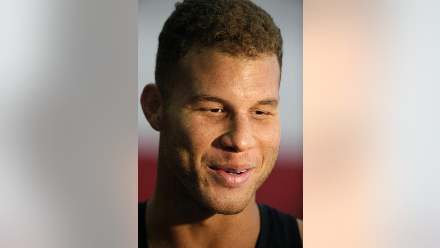 Los Angeles Clippers' Blake Griffin speaks with the media after practice at training camp Tuesday, Sept. 30, 2014, in Las Vegas. (AP Photo/John Locher)