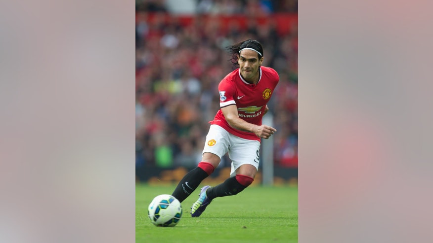 Manchester United's Radamel Falcao Garcia passes the ball up field during his team's English Premier League soccer match against West Ham United at Old Trafford Stadium, Manchester, England, Saturday Sept. 27, 2014. (AP Photo/Jon Super)
