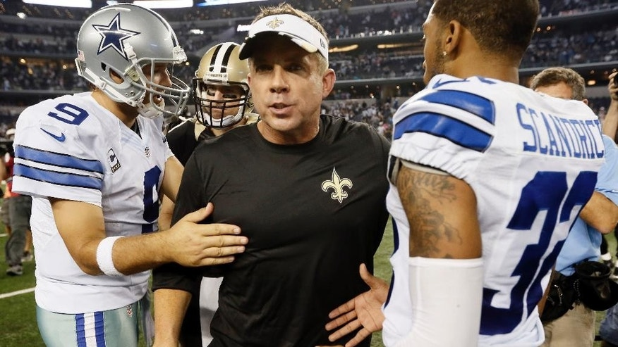 Dallas Cowboys' Tony Romo (9) and Orlando Scandrick (32) greet New Orleans Saints head coach Sean Payton at midfield after an NFL football game, Sunday, Sept. 28, 2014, in Arlington, Texas. The Cowboys won 38-17.  (AP Photo/Brandon Wade)