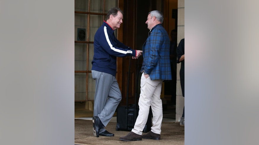 US Ryder Cup captain  Tom Watson, left, speaks with  European  Ryder Cup captain Paul McGinley as he leaves The Gleneagles Hotel, Gleneagles Scotland Monday Sept. 29, 2014.  The European tyeam retained the Ryder Cup beating the U.S. team 16 1/2-11 1/2. (AP Photo/Andrew Milligan/PA) UNITED KINGDOM OUT