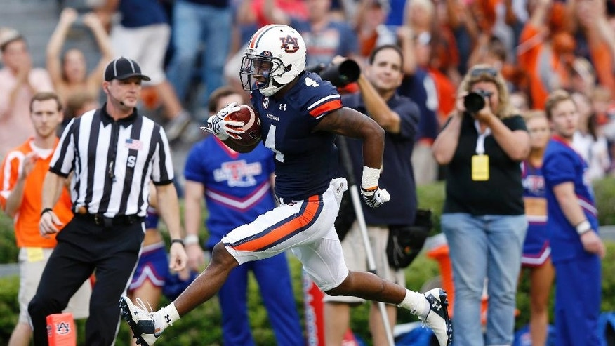 Auburn wide receiver Quan Bray runs to the end zone for a touchdown during the second half of an NCAA college football game against Louisiana Tech on Saturday, Sept. 27, 2014, in Auburn, Ala. (AP Photo/Brynn Anderson)