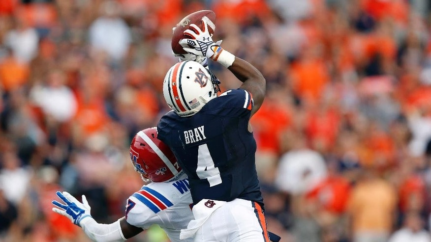 Auburn wide receiver Quan Bray (4) scores a touchdown against Louisiana Tech defensive back Xavier Woods during the second half of an NCAA college football game on Saturday, Sept. 27, 2014, in Auburn, Ala. (AP Photo/Brynn Anderson)