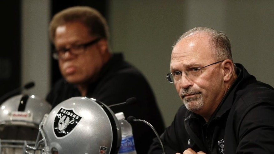 Oakland Raiders general manager Reggie McKenzie, left, and interim coach Tony Sparano answer questions from reporters Tuesday, Sept. 30, 2014, in Alameda, Calif. The NFL football team named Sparano as interim coach a day after the firing of Dennis Allen. (AP Photo/Ben Margot)