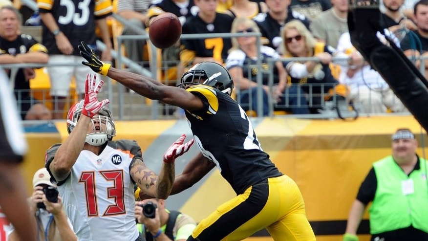 Tampa Bay Buccaneers wide receiver Mike Evans (13) catches a touchdown pass as Pittsburgh Steelers cornerback Cortez Allen (28) defends in the first quarter of an NFL football game on Sunday, Sept. 28, 2014, in Pittsburgh. (AP Photo/Don Wright)