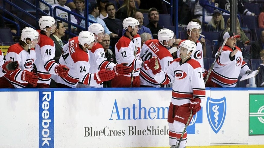Carolina Hurricanes' Ryan Murphy (7) celebrates with teammates on the bench after scoring a goal in the second period of a preseason NHL hockey game against the St. Louis Blues, Tuesday, Sept. 30, 2014 in St. Louis. (AP Photo/Tom Gannam)