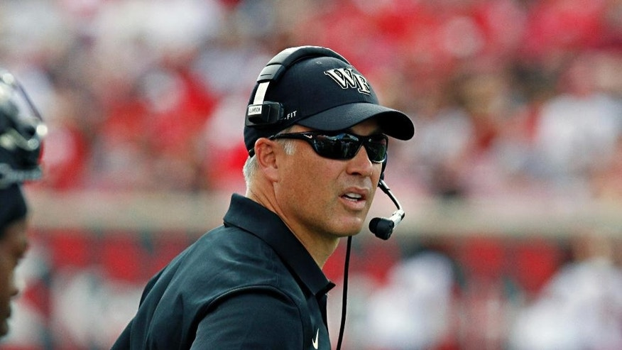 Wake Forest coach Dave Clawson watches his team against Louisville in their NCAA college football game in Louisville, Ky., Saturday, Sept. 27, 2014. Louisville came from behind to beat Wake Forest 20-10. (AP Photo/Garry Jones)