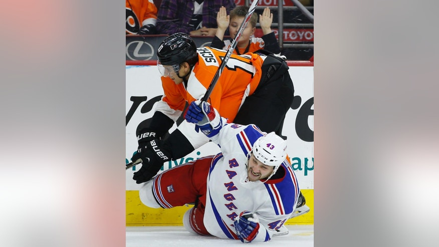 Philadelphia Flyers' Brayden Schenn, top, collides with New York Rangers' Nick Tarnasky during the second period of a preseason NHL hockey game, Tuesday, Sept. 30, 2014, in Philadelphia. (AP Photo/Matt Slocum)