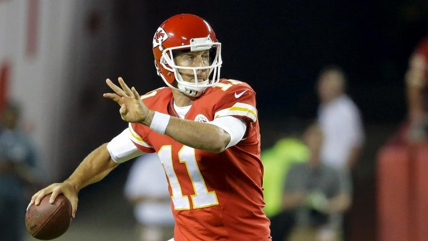 Kansas City Chiefs quarterback Alex Smith throws during the first quarter of an NFL football game against the New England Patriots, Monday, Sept. 29, 2014, in Kansas City, Mo. (AP Photo/Nati Harnik)