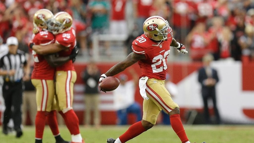 San Francisco 49ers defensive back Perrish Cox (20) celebrates after intercepting Philadelphia Eagles quarterback Nick Foles during the fourth quarter of an NFL football game in Santa Clara, Calif., Sunday, Sept. 28, 2014. The 49ers won 26-21. (AP Photo/Ben Margot)