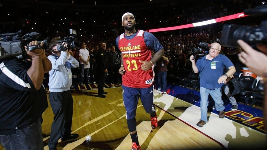 Cleveland Cavaliers' LeBron James is introduced during an NBA scrimmage basketball game Wednesday, Oct. 1, 2014, in Cleveland. (AP Photo/Tony Dejak)
