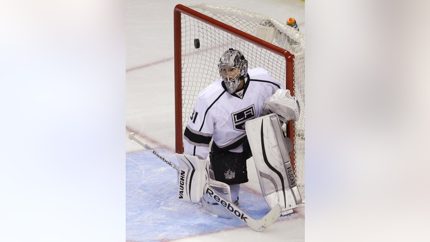 Los Angeles Kings goalie Martin Jones defends a shot on goal against the San Jose Sharks during the third period of an NHL preseason hockey game in San Jose, Calif., Tuesday, Sept. 30, 2014. The Kings won 4-1. (AP Photo/Jeff Chiu)