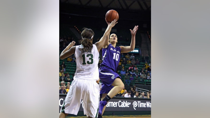 FILE - In this Jan. 22, 2014, file photo, Kansas State guard Leticia Romero (10), right, shoots over Baylor forward Nina Davis (13), left, in the first half of an NCAA college basketball game in Waco, Texas. Basketball isn't all that Breanna Stewart, Kia Nurse and Romero have to worry about while playing in the women's basketball world championship. They also need to focus on academics as all three are in college and classes are well underway. (AP Photo/Waco Tribune Herald, Rod Aydelotte, File)