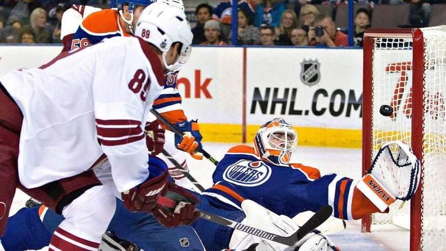 Arizona Coyotes' Mikkel Boedker (89) scores a goal against Edmonton Oilers goalie Ben Scrivens during the first period of an NHL hockey preseason game, Wednesday, Oct. 1, 2014, in Edmonton, Alberta. (AP Photo/The Canadian Press, Jason Franson)