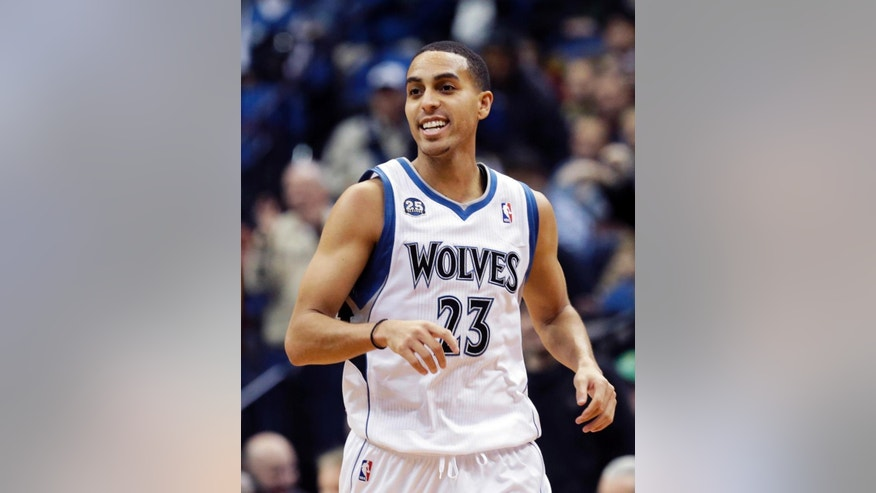 FILE - In this Friday, Nov. 22, 2013 file photo, Minnesota Timberwolves' Kevin Martin smiles after a basket in the second half of an NBA basketball game against the Brooklyn Nets in Minneapolis. Kevin Martin said he cut corners during practice in his first season with the Minnesota Timberwolves last year. Martin is making a more concerted effort to be a leader on this young team, Wednesday, Oct. 1, 2014. (AP Photo/Jim Mone, File)