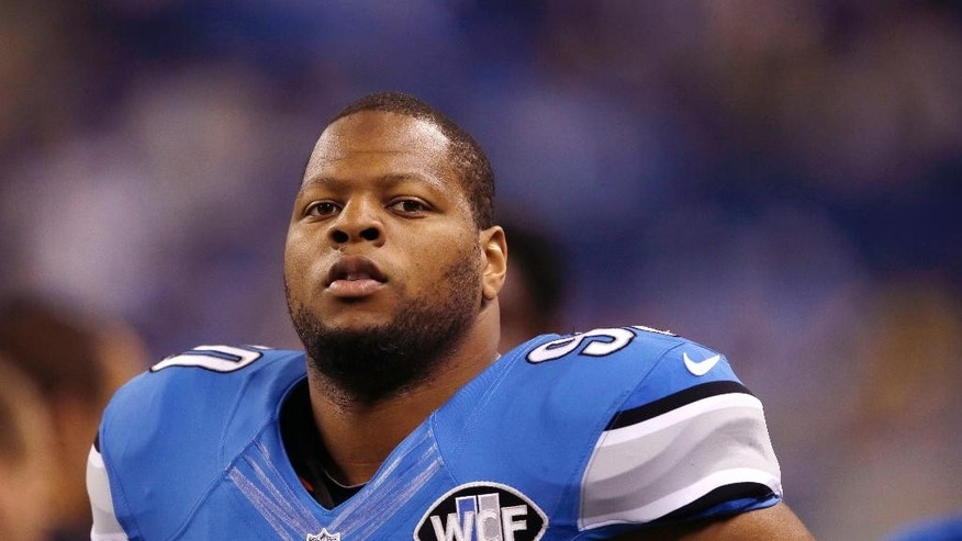 FILE - This Sept. 21, 2014, file photo shows Detroit Lions defensive tackle Ndamukong Suh during warm-ups before an NFL football game against the Green Bay Packers in Detroit. Suh can become a free agent after this season, and there's already talk he could be headed elsewhere, but that doesn't seem to be a distraction for the Lions. (AP Photo/Carlos Osorio, File)