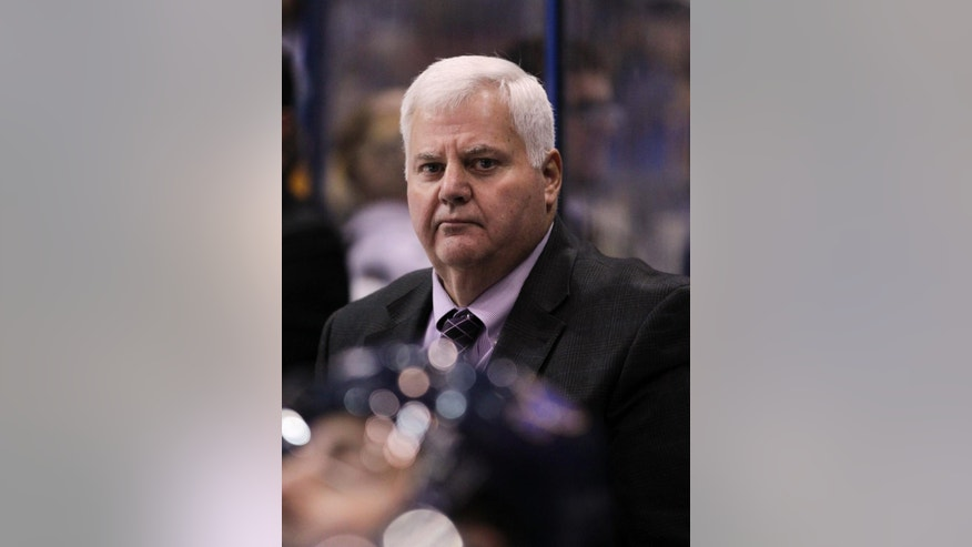 St. Louis Blues head coach Ken Hitchcock watches the action from the bench in the third period of a preseason NHL hockey game against the Carolina Hurricanes, Tuesday, Sept. 30, 2014 in St. Louis. The Blues beat the Hurricanes 3-1. (AP Photo/Tom Gannam)