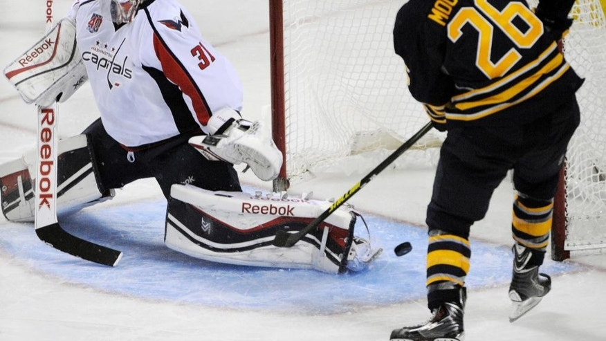 Washington Capitals goaltender Philipp Grubauer (31), of Germany, makes a save on Buffalo Sabres left winger Matt Moulson (26) during the third period of an NHL hockey preseason game, Wednesday, Oct., 1, 2014, in Buffalo, N.Y. Buffalo won 6-1.  (AP Photo/Gary Wiepert)