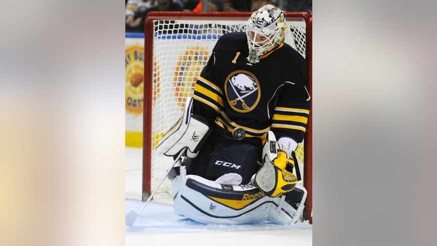 Buffalo Sabres goaltender Jhonas Enroth, of Sweden, makes a save against the Washington Capitals during the second period of an NHL hockey preseason game, Wednesday, Oct., 1, 2014, in Buffalo, N.Y. (AP Photo/Gary Wiepert)