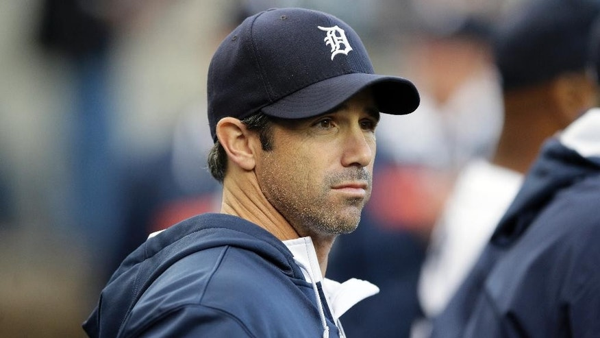 This photo taken Sept. 13, 2014 shows Detroit Tigers manager Brad Ausmus is seen in the dugout before the first inning of a baseball game against the Cleveland Indians in Detroit. Ausmus, and Washington Nationals manager Matt Williams, whose Nationals will host Game 1 of an NL Division Series on Friday are attempting to accomplish something that's only happened four times in baseball's long history _ and once in the past half-century: win a World Series as a first-time manager in the majors.  (AP Photo/Carlos Osorio)