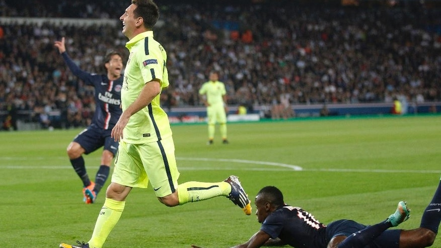 Barcelona's Lionel Messi, center, smiles after scoring his side's first goal during the Champions League Group F soccer match between Paris Saint German and Barcelona at Parc des Princes stadium in Paris, France, Tuesday, Sept. 30, 2014. (AP Photo/Michel Euler)