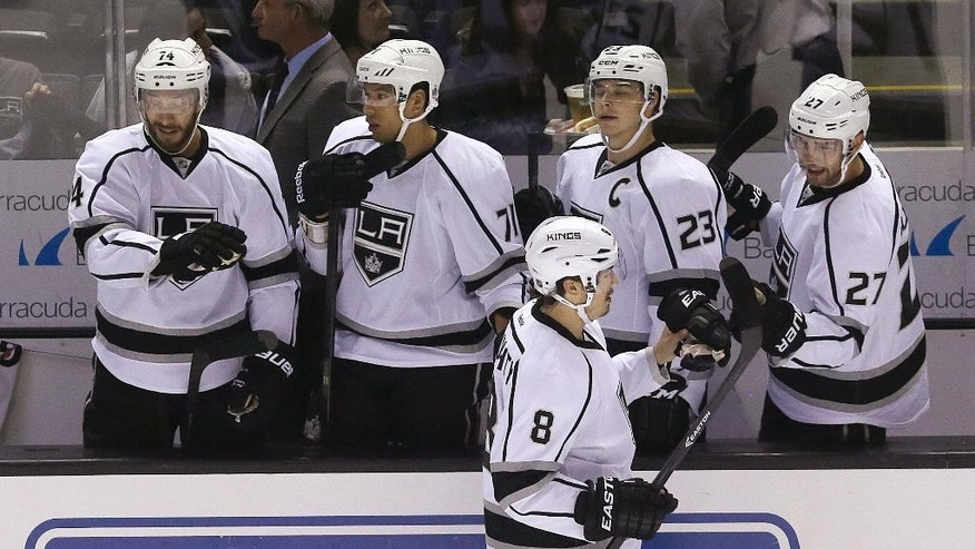 Los Angeles Kings defenseman Drew Doughty (8) celebrates with teammates after scoring against the San Jose Sharks during the first period of an NHL preseason hockey game in San Jose, Calif., Tuesday, Sept. 30, 2014. (AP Photo/Jeff Chiu)