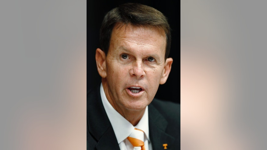 FILE - In this Sept. 5, 2011, file photo, Dave Hart speaks at a news conference during which he was introduced as athletic director at the University of Tennessee, in Knoxville, Tenn. Former Lady Vols media director Debby Jennings has reached a $320,000 settlement in her lawsuit against the University of Tennessee and athletic director Dave Hart, Thursday, Oct. 2, 2014.  (AP Photo/Wade Payne, File)