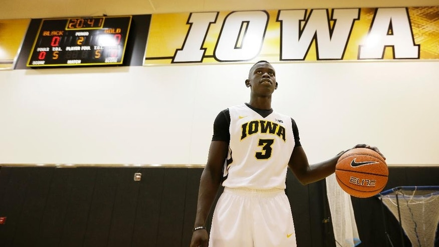 Iowa guard Peter Jok dribbles a basketball during the school's annual basketball media day, Thursday, Oct. 2, 2014, in Iowa City, Iowa. (AP Photo/Charlie Neibergall)