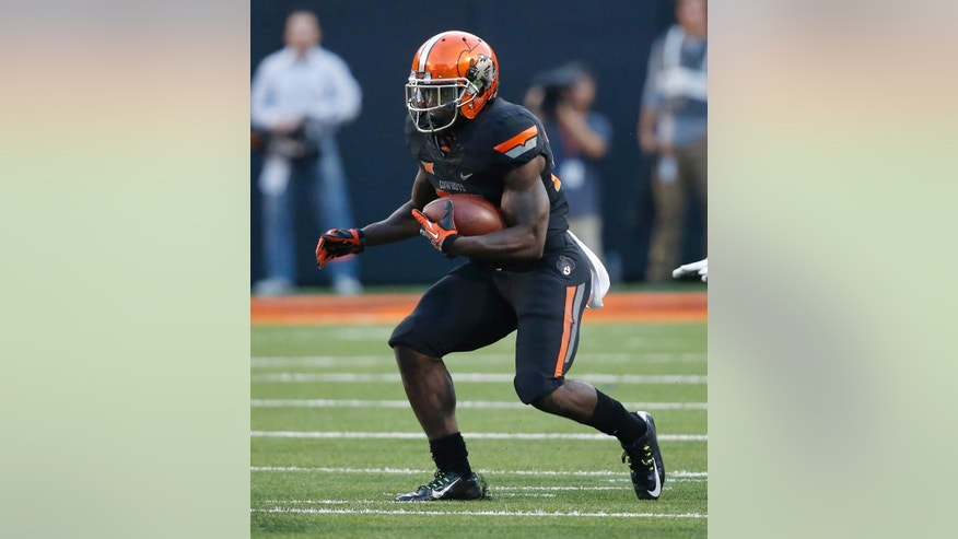 FILE - In this Sept. 25, 2014, file photo, Oklahoma State wide receiver Tyreek Hill (24) runs with the ball during an NCAA college football game between against Texas Tech in Stillwater, Okla. James Washington and Tyreek Hill have emerged as deep threats for the rapidly improving Daxx Garman. (AP Photo/Sue Ogrocki, File)