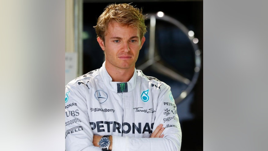 Mercedes driver Nico Rosberg of Germany folds his arms at his team's garage at the Suzuka Circuit in Suzuka, central Japan, Thursday, Oct. 2, 2014 ahead of Sunday's Japanese Formula One Grand Prix. (AP Photo/Shizuo Kambayashi)