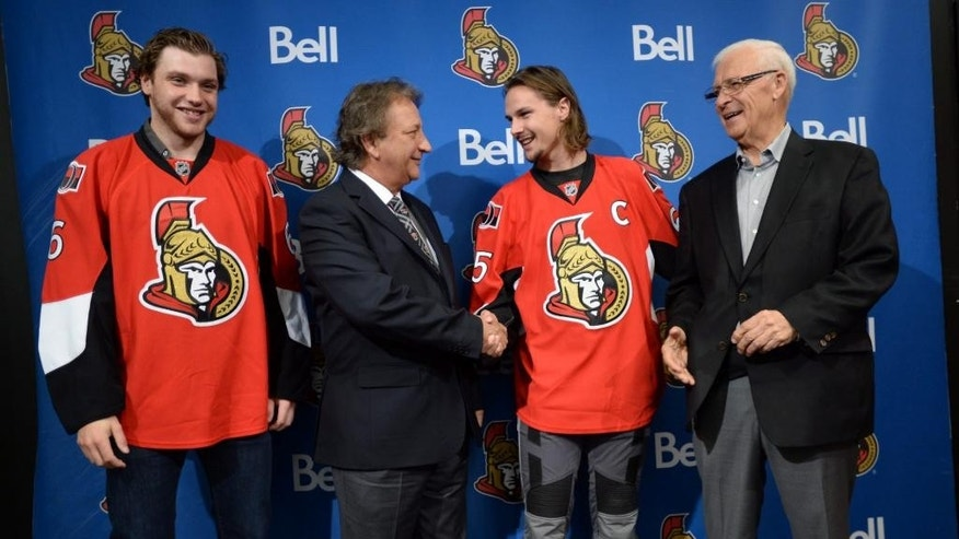 Bobby Ryan, left, Eugene Melnyk, second from left, owner of the Ottawa Senators Hockey Club, Erik Karlsson, second from right, and Senators general manager Bryan Murray, right, appear at a news conference Thursday, Oct. 2, 2014 in Ottawa. Karlsson was named captain of the Senators and Ryan was signed to a seven-year, $50.75-million contract extension.(AP Photo/The Canadian Press, Sean Kilpatrick)
