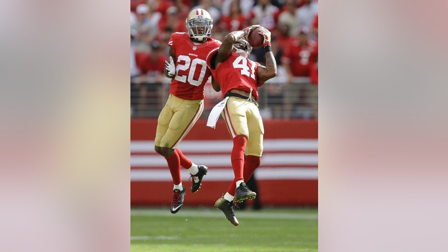 San Francisco 49ers strong safety Antoine Bethea (41) intercepts a pass from Philadelphia Eagles quarterback Nick Foles in front of defensive back Perrish Cox (20) during the third quarter of an NFL football game in Santa Clara, Calif., Sunday, Sept. 28, 2014. (AP Photo/Ben Margot)