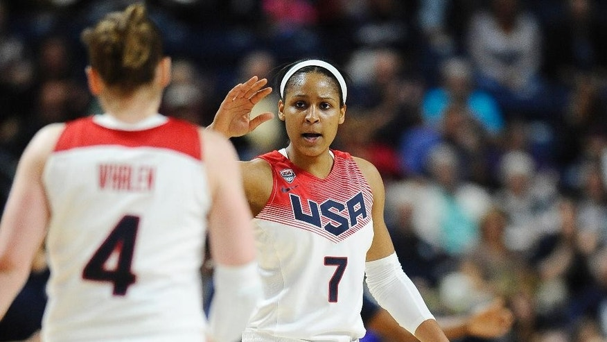 FILE - In this Sept. 15, 2014, file photo, USA's Maya Moore, right, high fives teammate Lindsay Whalen during the first half of an women's exhibition basketball game against Canada in Bridgeport, Conn. Standing in the way of another trip to the medal round is France, a team that handed the Americans a rare defeat on Sept. 21 in an exhibition game. The teams will meet again in the quarterfinals of the tournament Friday night.(AP Photo/Jessica Hill, File)
