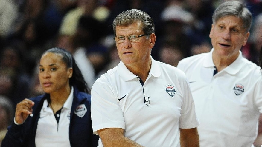 FILE - In this Sept. 15, 2014, file photo, USA head coach Geno Auriemma watches play during the second half of a women's exhibition basketball game against Canada in Bridgeport, Conn. Standing in the way of another trip to the medal round is France, a team that handed the Americans a rare defeat on Sept. 21 in an exhibition game. The teams will meet again in the quarterfinals of the tournament Friday night. (AP Photo/Jessica Hill)