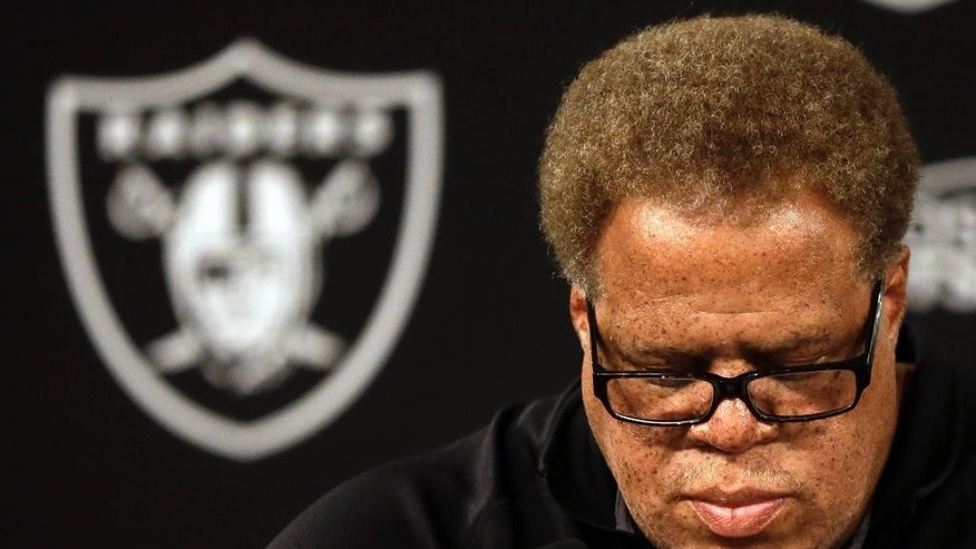 Oakland Raiders general manager Reggie McKenzie takes questions from reporters during a media conference Tuesday, Sept. 30, 2014, in Alameda, Calif. The Oakland Raiders named Tony Sparano as their interim head coach. (AP Photo/Ben Margot)