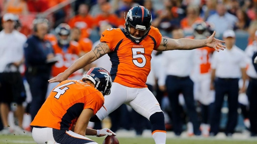 "FILE - In this Aug. 23, 2014, file photo, Denver Broncos kicker Matt Prater (5) boots the ball during the first half of an NFL preseason football game against the Houston Texans in Denver. The Broncos have cut ties with Prater, Friday, Oct. 3, 2014, who's about to come off his four-game suspension. In a statement, GM John Elway said releasing Prater was ""a very difficult football decision."" (AP Photo/Jack Dempsey, File)"