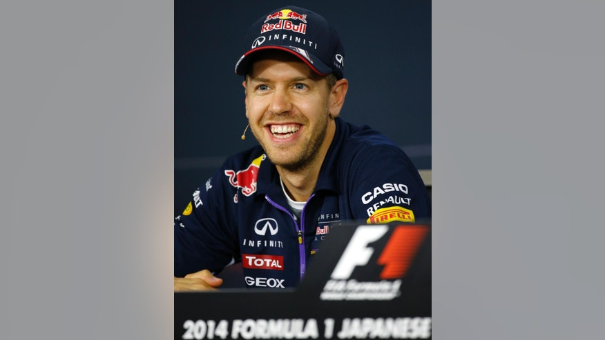 Red Bull Racing driver Sebastian Vettel of Germany listens to a reporter's questions during a press conference at the Suzuka Circuit in Suzuka, central Japan, Thursday, Oct. 2, 2014 ahead of Sunday's Japanese Formula One Grand Prix. (AP Photo/Shizuo Kambayashi)