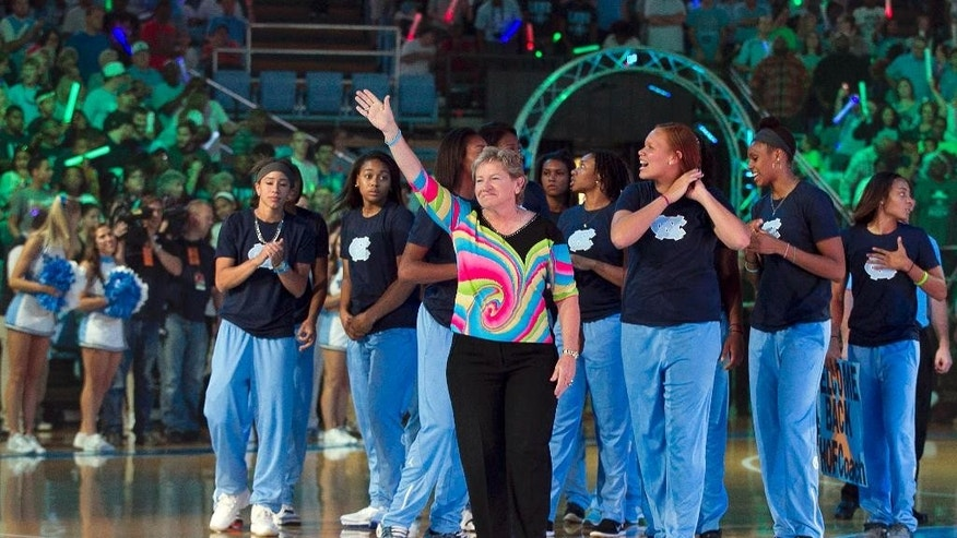 North Carolina women's basketball coach Sylvia Hatchell acknowledges a standing ovation as she is introduced with her team during the annual Late Night With Roy kickoff to the college basketball season, Friday, Oct. 3, 2014, at the Smith Center in Chapel HIll, N.C. Hatchell missed all of last season due to a battle with cancer. (AP Photo/The News & Observer, Robert Willett)