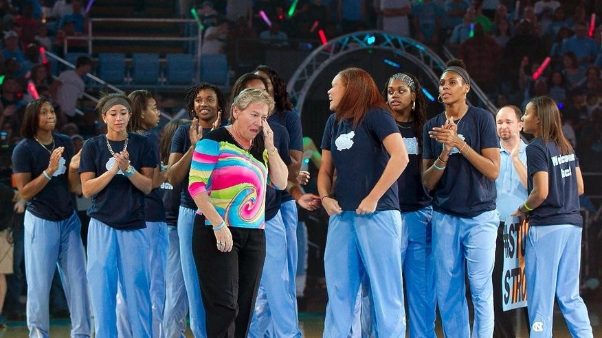 North Carolina women's basketball coach Sylvia Hatchell wipes away the tears as she is introduced with her team during the annual Late Night With Roy kickoff to the college basketball season, Friday, Oct. 3, 2014, at the Smith Center in Chapel HIll, N.C. Hatchell missed all of last season due to a battle with cancer. (AP Photo/The News & Observer, Robert Willett)