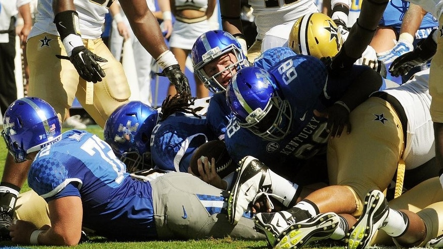 University of Kentucky quarterback Patrick Towles looks for the call after setting the ball in the endzone for a touchdown against Vanderbilt during an NCAA football game, Saturday, Sept. 27, 2014 at Commonwealth Stadium in Lexington, Ky. (AP Photo/John Flavell)