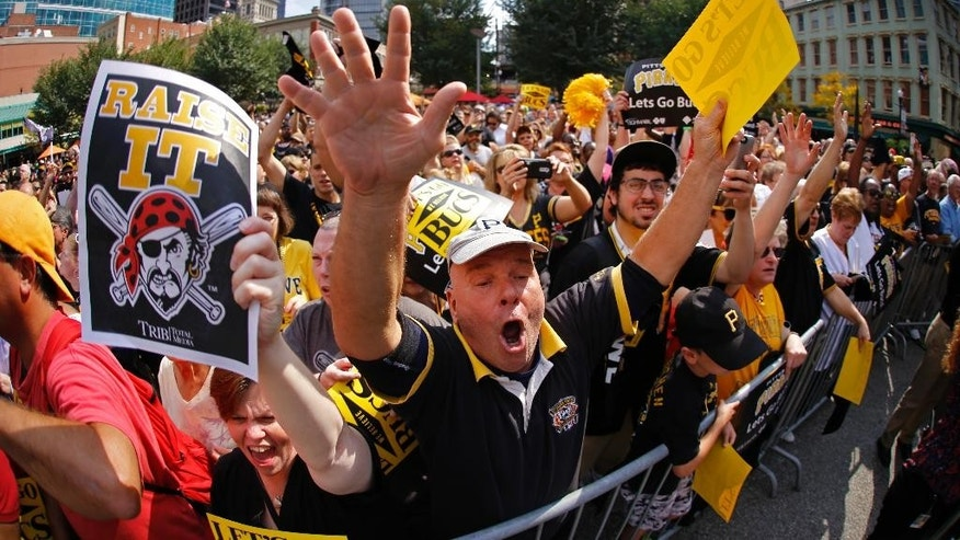 In this image made with a fisheye lens, Pittsburgh Pirates fans gather at a noon pep rally in downtown Pittsburgh Tuesday, Sept. 30, 2014. The Pirates face the San Francisco Giants in the wild card game in Pittsburgh Wednesday night. (AP Photo/Gene J. Puskar)