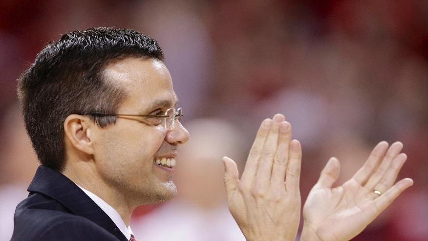 FILE - In this March 9, 2014, file photo, Nebraska coach Tim Miles applauds his seniors prior to an NCAA college basketball game against Wisconsin in Lincoln, Neb. Nebraska is picked as high as second in the Big Ten and 11th nationally in preseason publications after its 19-win season. The Huskers are in line for their first preseason ranking, and second ever, since they were No. 25 to start 1992-93. (AP Photo/Nati Harnik, File)