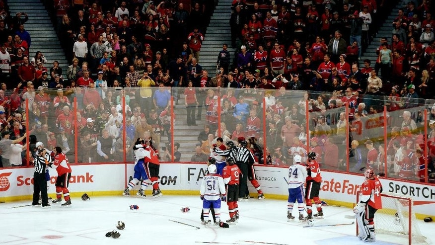Ottawa Senators and Montreal Canadiens fight during third period of a preseason NHL hockey game in Ottawa, Ontario, on Friday, Oct. 3, 2014. (AP Photo/The Canadian Press, Sean Kilpatrick)