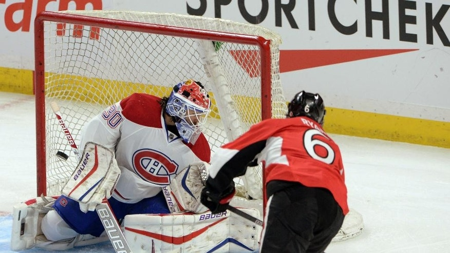 Ottawa Senators' Bobby Ryan scores against Montreal Canadiens' Peter Budai during overtime in a preseason NHL hockey game in Ottawa, Ontario, on Friday, Oct. 3, 2014. The Senators won 4-3. (AP Photo/The Canadian Press, Sean Kilpatrick)